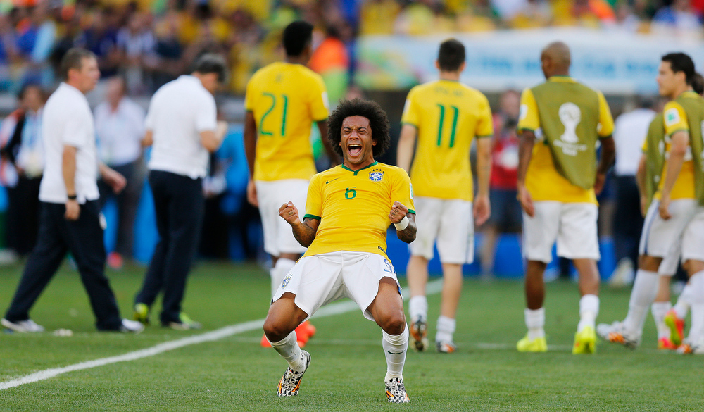 . Brazil\'s Marcelo celebrates  after the World Cup round of 16 soccer match between Brazil and Chile at the Mineirao Stadium in Belo Horizonte, Brazil, Saturday, June 28, 2014. Brazil won 3-2 on penalties. Brazil won 3-2 on penalties.(AP Photo/Frank Augstein)