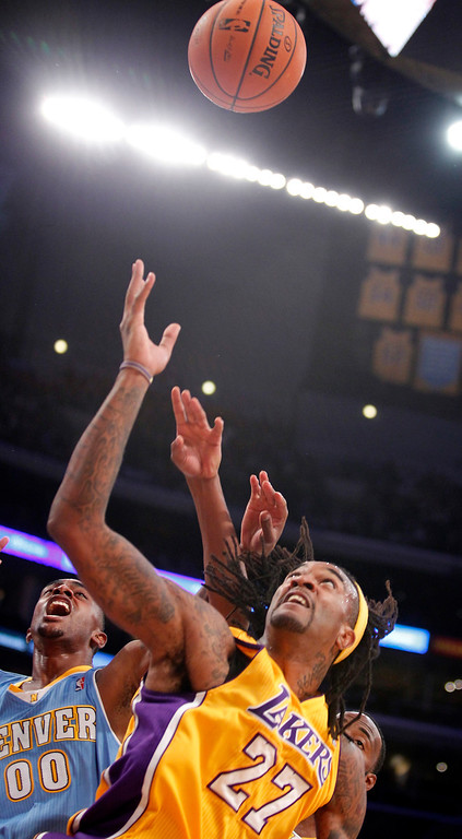 . Denver Nuggets forward Darrell Arthur, left, battles for the ball against Los Angeles Lakers center Jordan Hill in the first quarter during an NBA preseason basketball game Sunday, Oct. 6, 2013 in Los Angeles. (AP Photo/Alex Gallardo)