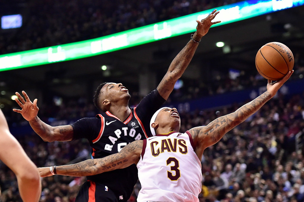 . Cleveland Cavaliers guard Isaiah Thomas (3) goes up for a basket as Toronto Raptors guard Delon Wright (55) defends during the second half of an NBA basketball game Thursday, Jan. 11, 2018, in Toronto. (Frank Gunn/The Canadian Press via AP)