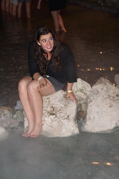Jane expressing how hot the water is flowing into Lake Garda in Sirmione