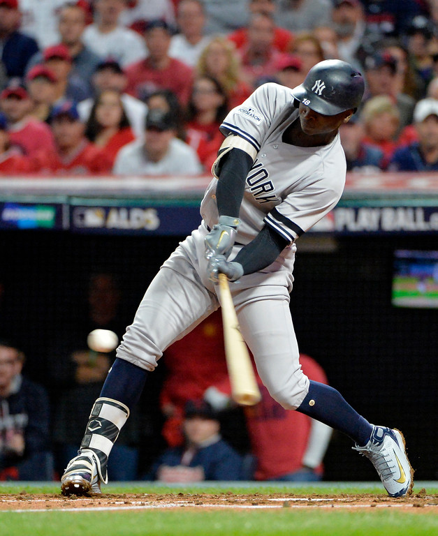 . New York Yankees\' Didi Gregorius hits a two-run home run off Cleveland Indians starting pitcher Corey Kluber during the third inning of Game 5 of a baseball American League Division Series, Wednesday, Oct. 11, 2017, in Cleveland. (AP Photo/Phil Long)