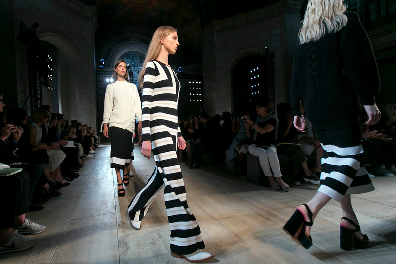 . Models walk in the finale of the Victoria Beckham Spring 2015 collection at its modeled during Fashion Week, in New York,  Sunday, Sept. 7, 2014. (AP Photo/Richard Drew)
