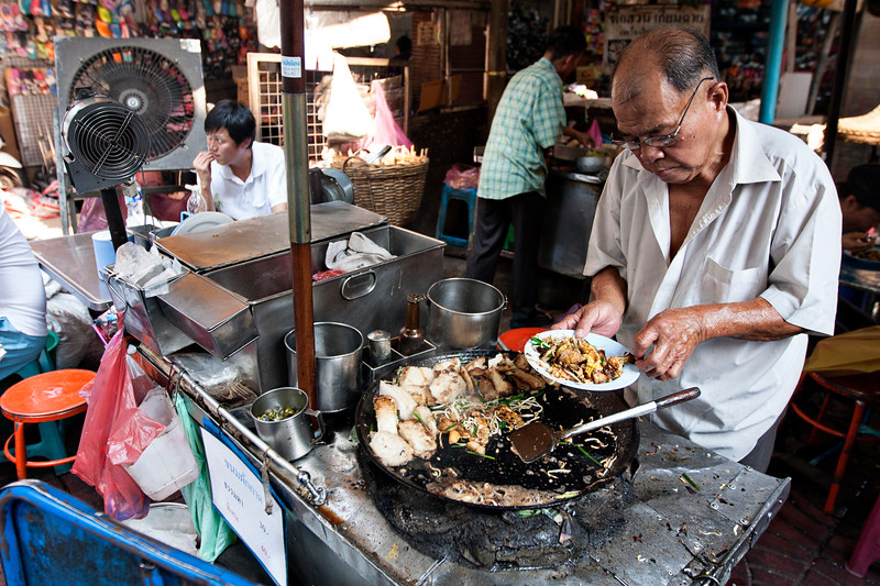 Cooking on the street in Chinatown, Bangkok.