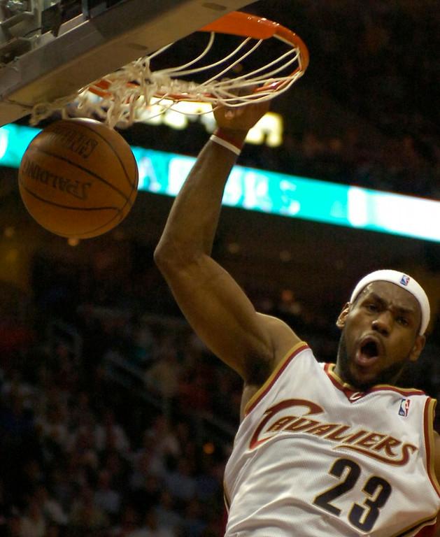 . MORNING JOURNAL/DAVID RICHARD LeBron James slam dunks last night in the second half against Washington.