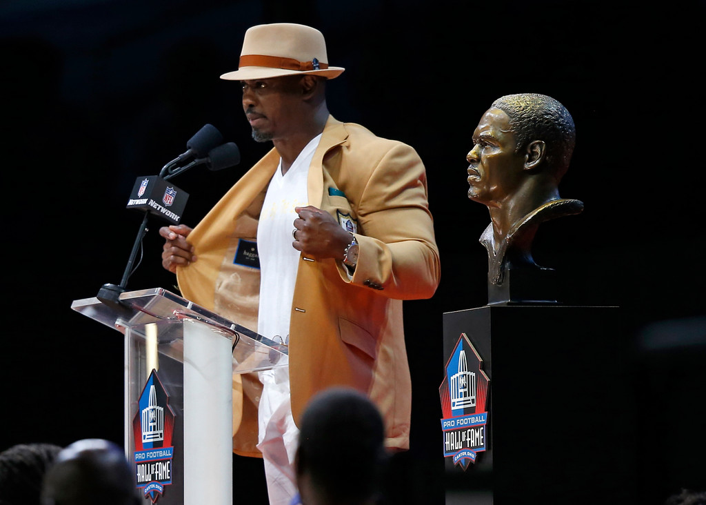 . Former NFL player Brian Dawkins delivers his speech during an induction ceremony at the Pro Football Hall of Fame Saturday, Aug. 4, 2018, in Canton, Ohio. (AP Photo/Ron Schwane)