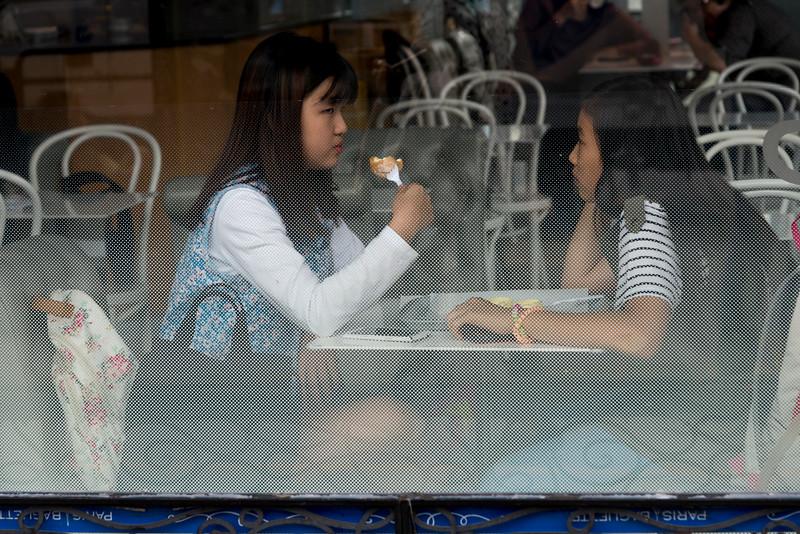 Female friends sitting at restaurant, Seoul, South Korea