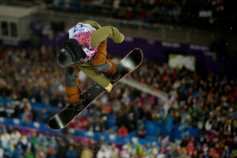 . Switzerland\'s David Habluetzel makes a front-side grab during the men\'s snowboard halfpipe final. Sochi 2014 Winter Olympics on Tuesday, February 11, 2014. (Photo by AAron Ontiveroz/The Denver Post)