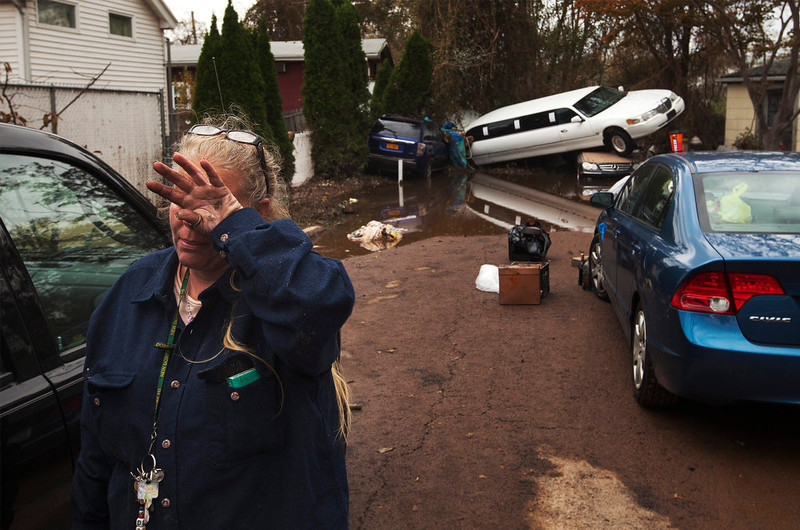 ". A woman weeps after learning that a neighbor presumed missing is okay while cleaning out her home in a neighborhood heavily damaged by Hurricane Sandy in the New Dorp Beach neighborhood of the Staten Island borough of New York, November 1, 2012. Deaths in the United States and Canada from Sandy, the massive storm that hit the U.S. East Coast this week, rose to at least 95 on Thursday after the number of victims reported by authorities in New York City jumped and deaths in New Jersey and elsewhere also rose. ""Hurricane Sandy\"" was Google\'s number one most searched trending event of 2012. REUTERS/Lucas Jackson"