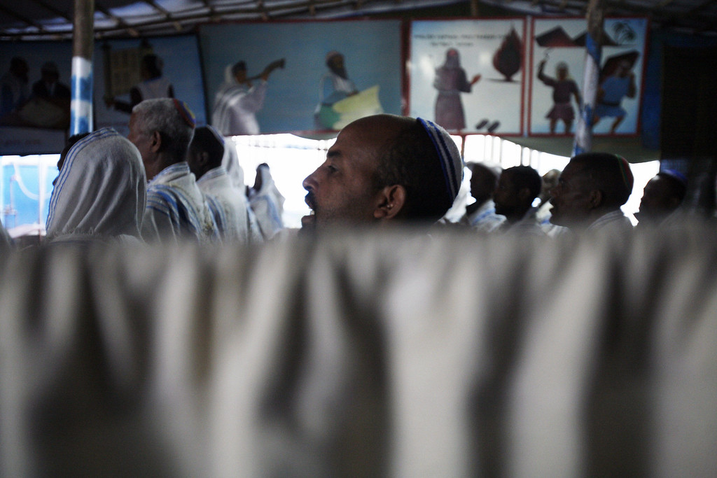 . Addis Ababa, ETHIOPIA: Ethiopian Jewish men pray at a synagogue 16 March 2007 in Ethiopia\'s capital Addis Ababa. Thousands of Ethiopian Jews have left their villages for Addis Abeba, hoping to be able to emigrate to Israel. JOSE CENDON/AFP/Getty Images