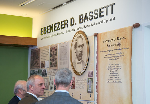03/20/19 Wesley Bunnell | Staff CCSU held the Ebenezer D. Bassett Hall among ceremony on Wednesday night honoring the first African American graduate from the school. CCSU officials stand in front of a wall dedicated to Ebenezer D. Bassett.