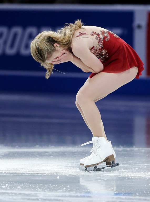 . Ashley Wagner becomes emotional at mid-ice after her performance during the skating spectacular after the U.S. Figure Skating Championships in Boston, Sunday, Jan. 12, 2014. Women\'s third finisher Mirai Nagasu, the only one of the top four finishers with Olympic experience, was bumped in favor of Wagner when U.S. Figure Skating announced the selections earlier Sunday. (AP Photo/Steven Senne)