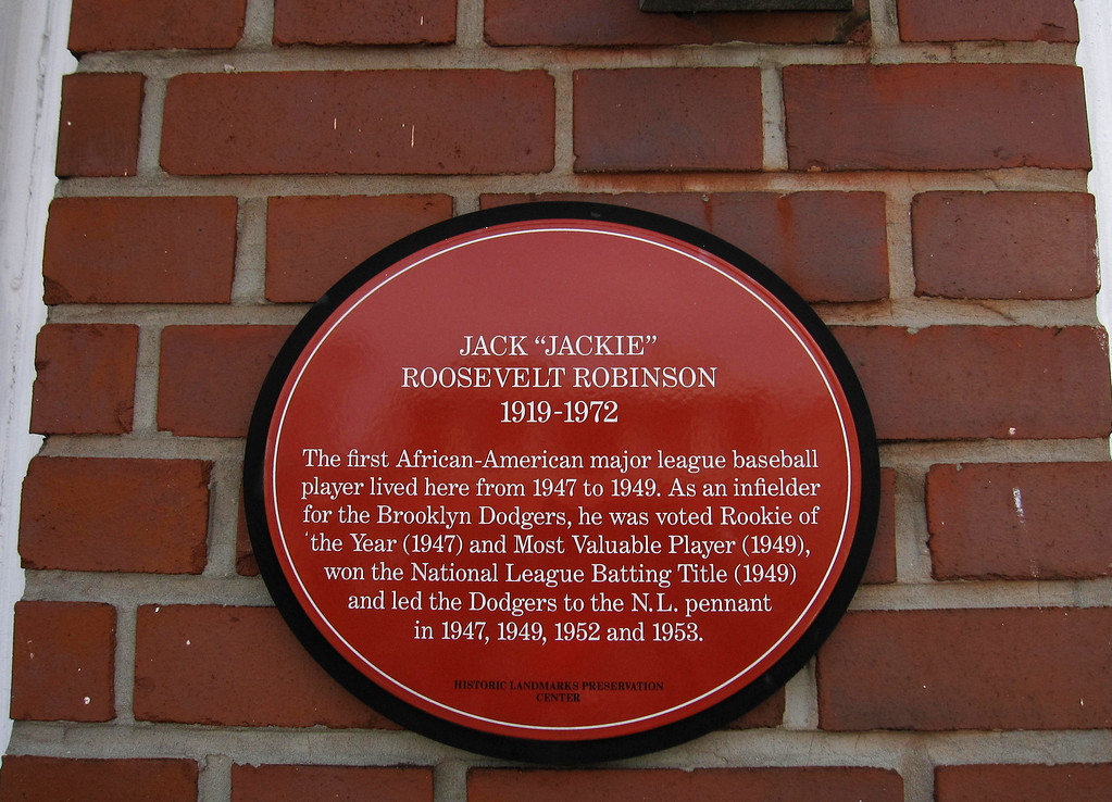 . This April 7, 2013 photo shows a plaque on a house in the Brooklyn borough of New York, where baseball great Jackie Robinson once lived. The sign says: �The first African-American major league baseball player lived here from 1947 to 1949.� A new movie, �42,� tells Robinson�s inspiring story as the man who integrated Major League Baseball. The house at 5224 Tilden Ave. in East Flatbush is one of a number of places in Brooklyn connected to Robinson. (AP Photo/Beth J. Harpaz)