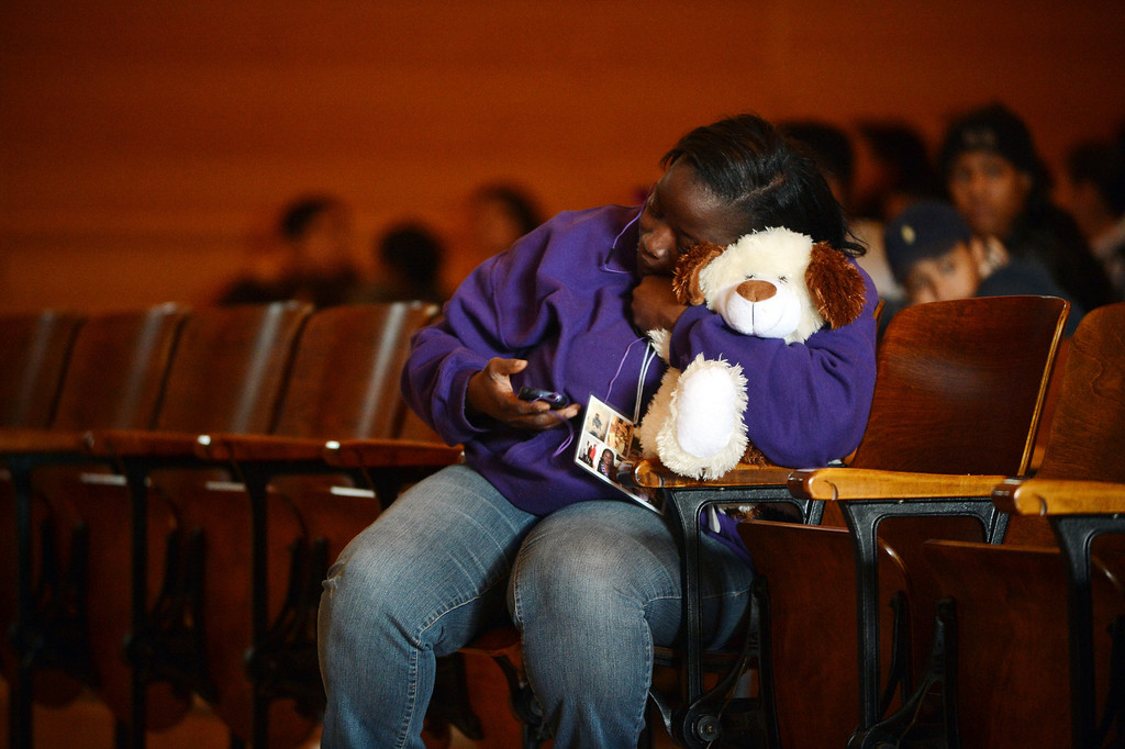 . Denise Washington, cousin of slain teenager Lee Weathersby III, holds a stuffed animal prior to a memorial service for her cousin held at Alliance Academy in Oakland, Calif. on Wednesday, Jan. 8, 2014. (Kristopher Skinner/Bay Area News Group)