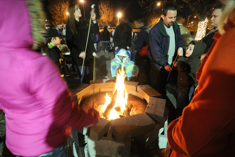 Visitors cook marshmallows on an open fire during the Xfinity Christmas at Chilhowie Park in Knoxville, TN on Friday, December 12, 2014. Copyright 2014 Jason Barnette