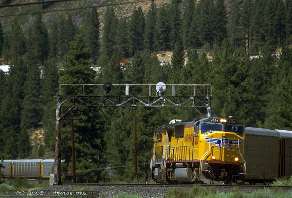 Mountain railroading in the Sierras means curves, curves, curves. This EMD/GE combo has their train wrapped around the large horseshoe at Hirschdale.