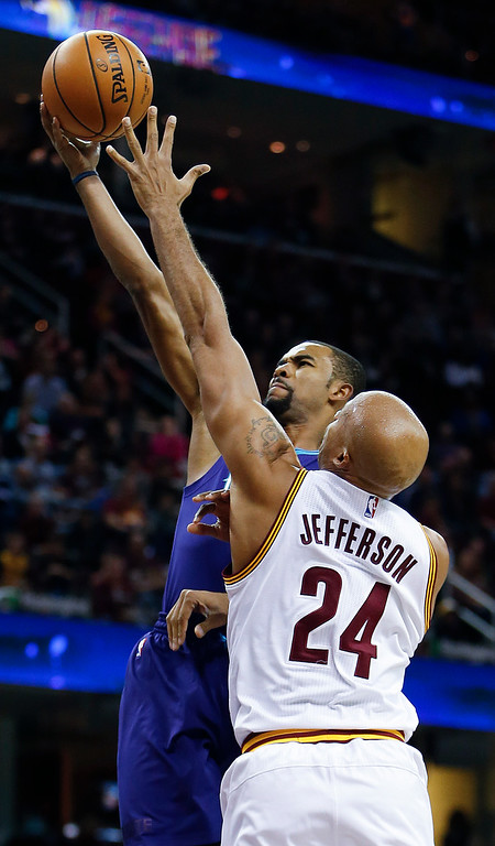 . Charlotte Hornets\' Ramon Sessions (7) goes up for a shot against Cleveland Cavaliers\' Richard Jefferson (24) during the second half of an NBA basketball game Sunday, Nov. 13, 2016, in Cleveland. The Cavaliers won 100-93. (AP Photo/Ron Schwane)