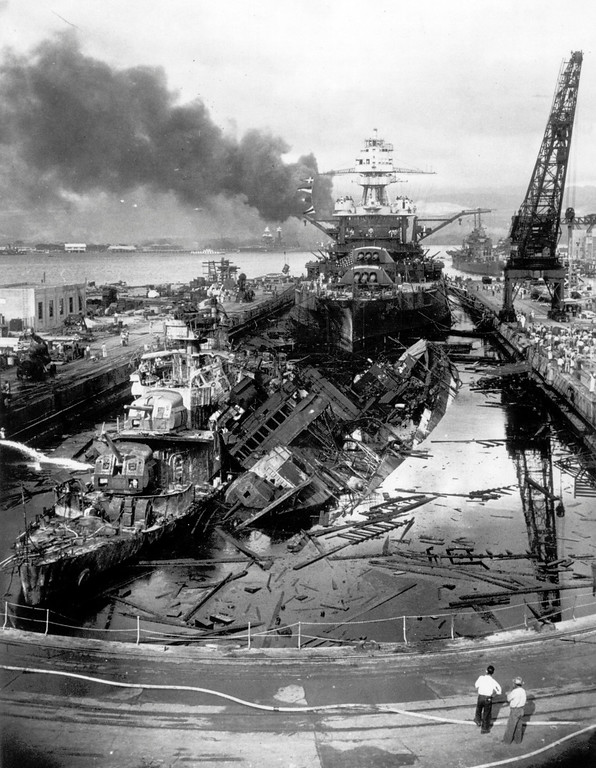 . Black smoke rises from the burning wrecks of several  U.S. Navy battleships after they had been bombed during the Japanese surprise attack on Pearl Harbor, Hawaii, on December 7, 1941. (AP Photo)