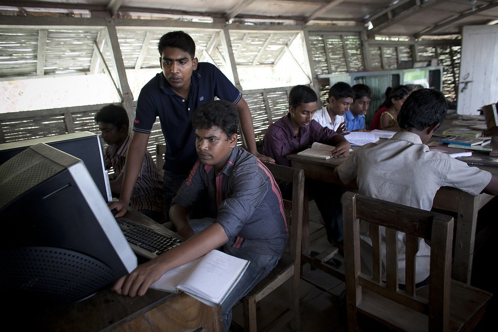 . People study in a solar powered floating library and technology center operated by Shidhulai Swanirvar Sangstha May 20, 2014 in Pabna district, Bangladesh.  (Photo by Allison Joyce/Getty Images)