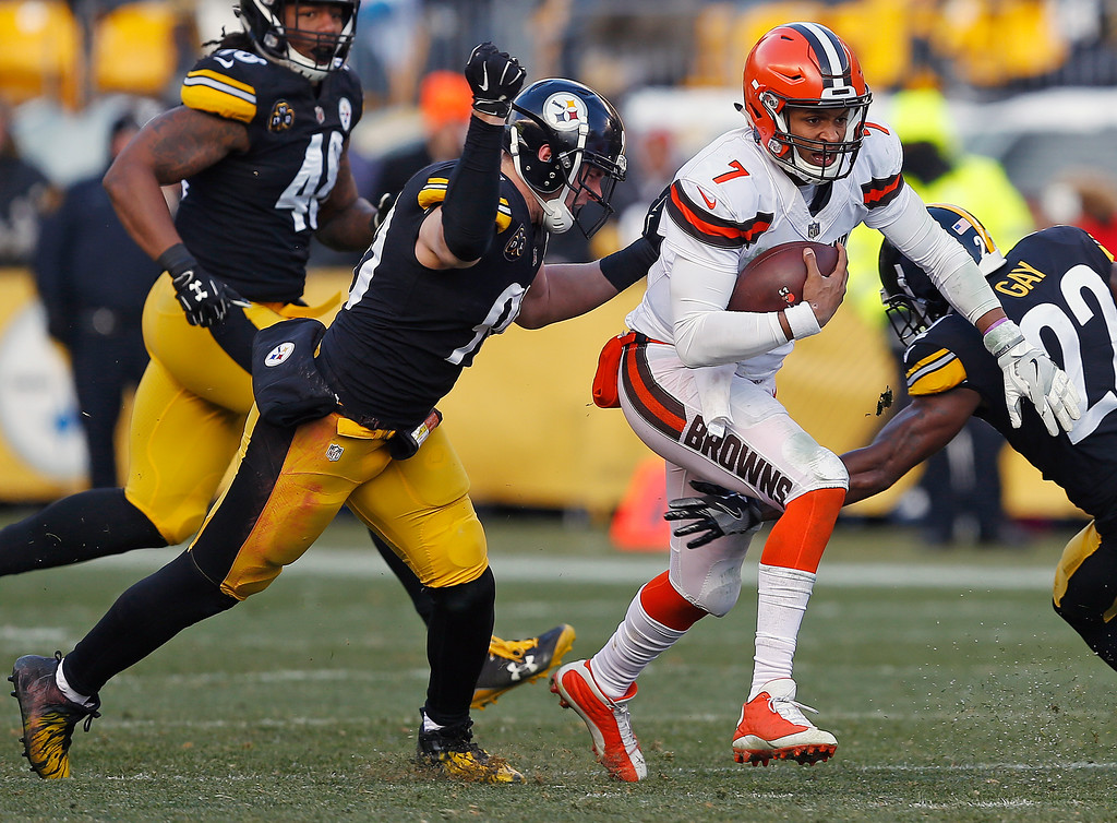 . Pittsburgh Steelers outside linebacker T.J. Watt (90) dives to make the tackle on Cleveland Browns quarterback DeShone Kizer (7) during the first half of an NFL football game in Pittsburgh, Sunday, Dec. 31, 2017. (AP Photo/Keith Srakocic)