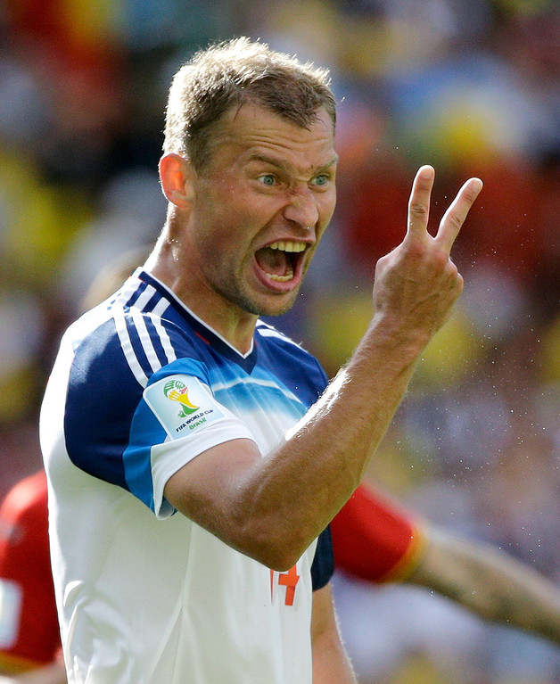 . Russia\'s Vasily Berezutsky gestures during the group H World Cup soccer match between Belgium and Russia at the Maracana Stadium in Rio de Janeiro, Brazil, Sunday, June 22, 2014. (AP Photo/Christophe Ena)