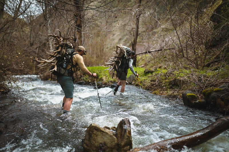 Sam Averett (samaverett) and Casey Barton (_caseybarton_) crossing a creek while shed hunting in Oregon.