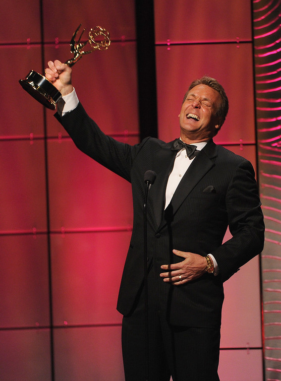 """. Actor Doug Davidson accepts the Outstanding Lead Actor in a Drama Series award for \""""The Young and the Restless\"""" onstage during The 40th Annual Daytime Emmy Awards at The Beverly Hilton Hotel on June 16, 2013 in Beverly Hills, California.  (Photo by Kevin Winter/Getty Images)"""