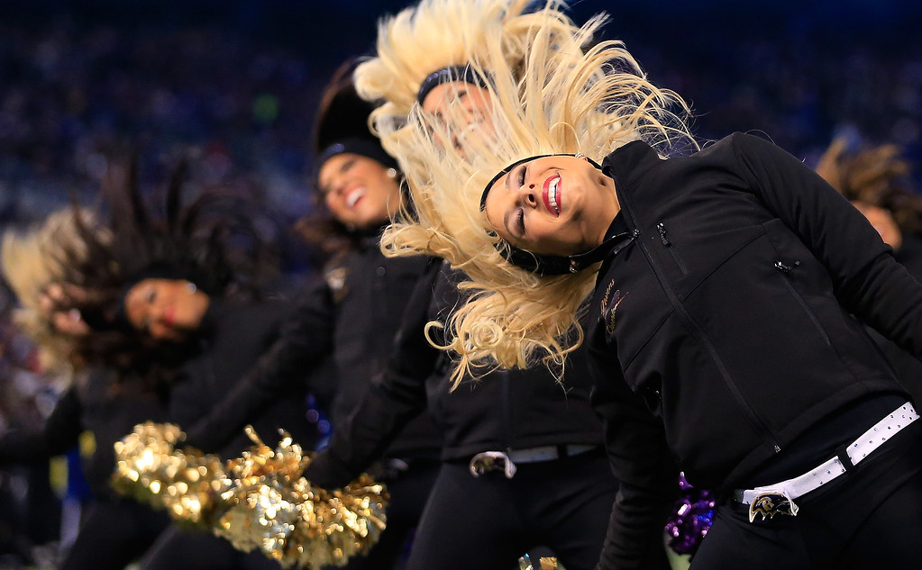 . Members of the Baltimore Ravens cheerleaders preform during the first half of the Ravens and Pittsburgh Steelers game at M&T Bank Stadium on November 28, 2013 in Baltimore, Maryland.  (Photo by Rob Carr/Getty Images)