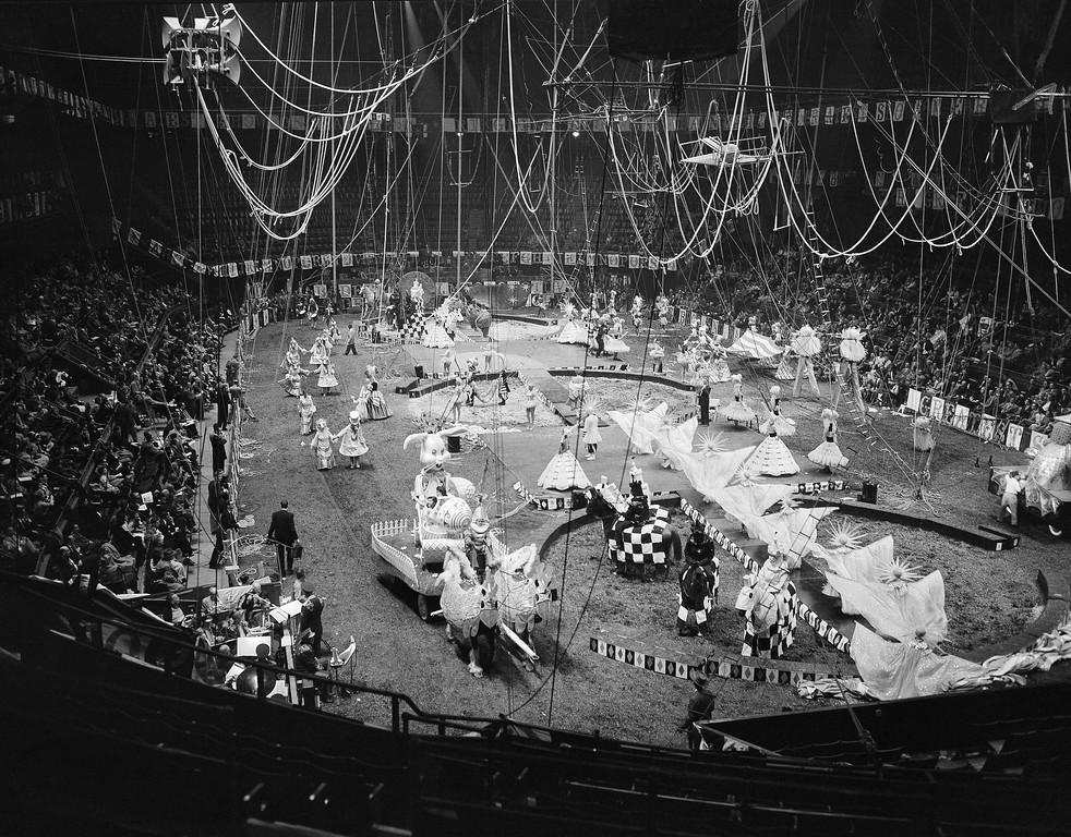 . Gaily costumed circus performers and animals dance their way over the Madison Square Garden tanbark in a Celestial Calendar Cavalcade, during rehearsal in New York, March 30, 1955, for opening of the 1955 edition of Ringling Brothers and Barnum and Bailey Circus. The cavalcade is one of 26 displays in the show which starts its annual tour with the current New York booking. (AP Photo/Matty Zimmerman)