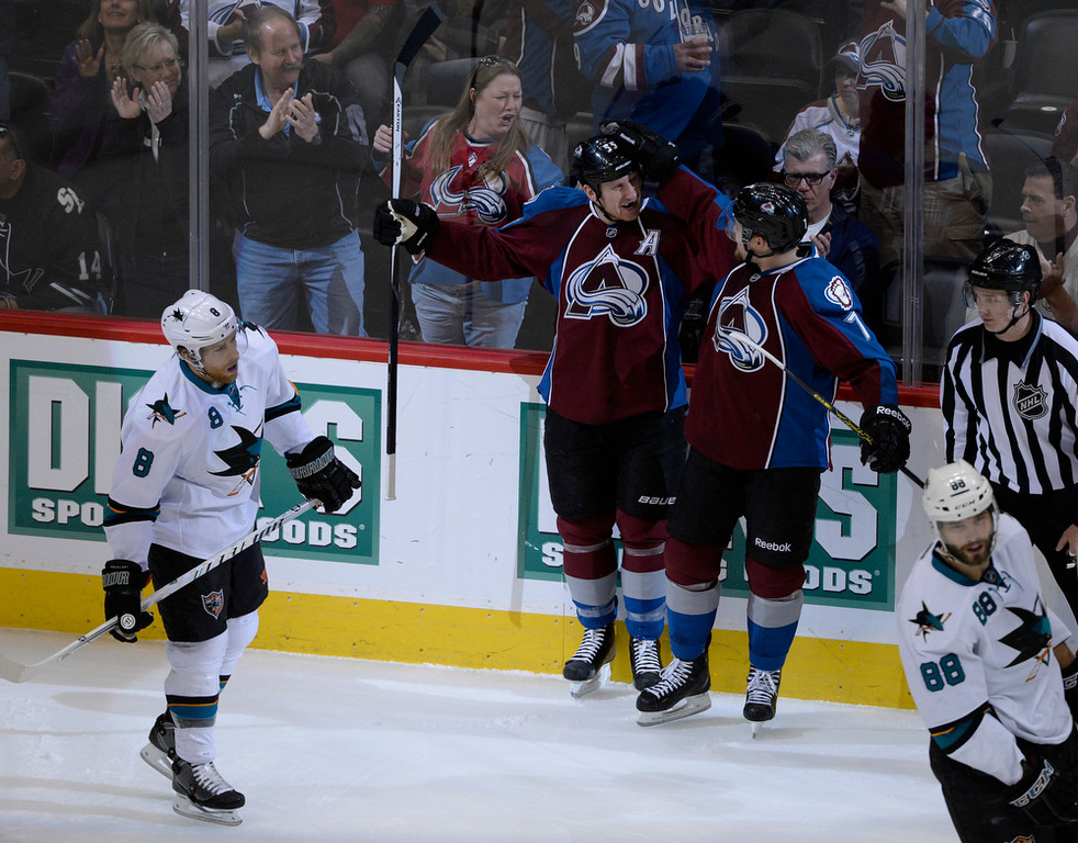 . Colorado Avalanche defenseman, Cody McLeod, left, celebrates with teammate, John Mitchell, after McLeod scored a short-handed goal against Joe Pavelski, left, and the San Jose Sharks in the first period of play at the Pepsi Center Saturday afternoon, March 29, 2014. (Photo By Andy Cross / The Denver Post)