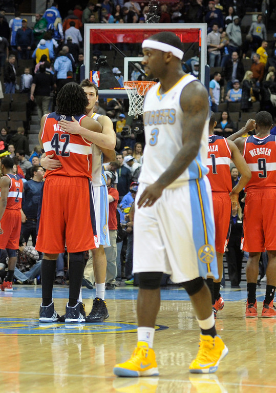 . DENVER, CO - JANUARY 18: Washington center Nene embraced Danilo Gallinari at the end of the game. The Washington Wizards defeated the Denver Nuggets 112-108 at the Pepsi Center Friday night, January 18, 2013. Karl Gehring/The Denver Post