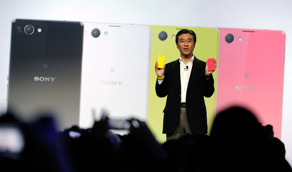 Description of . Sony Executive Vice President of Sony Corporation and Sony Mobile Communications President and CEO Kunimasa Suzuki displays a Sony Xperia Z compact phone during a Sony press event at the Las Vegas Convention Center for the 2014 International CES on January 6, 2014 in Las Vegas, Nevada. CES, the world's largest annual consumer technology trade show, runs from January 7-10 and is expected to feature 3,200 exhibitors showing off their latest products and services to about 150,000 attendees.  (Photo by David Becker/Getty Images)