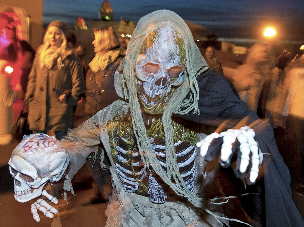 . An actor dressed as ghost plays during a Halloween celebration in the leisure park \'BELANTIS\', the largest theme park in eastern Germany, in Leipzig, central Germany, Thursday, Oct. 31, 2013. The  park staged a Halloween party with creepy surprises for the visitors. (AP Photo/Jens Meyer)