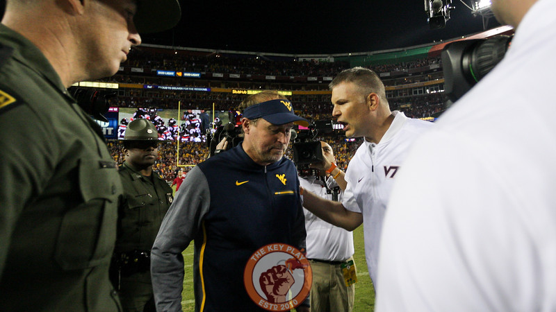 West Virginia head coach Dana Holgerson speaks with Virginia Tech head coach Justin Fuente after the game ends. (Mark Umansky/TheKeyPlay.com)