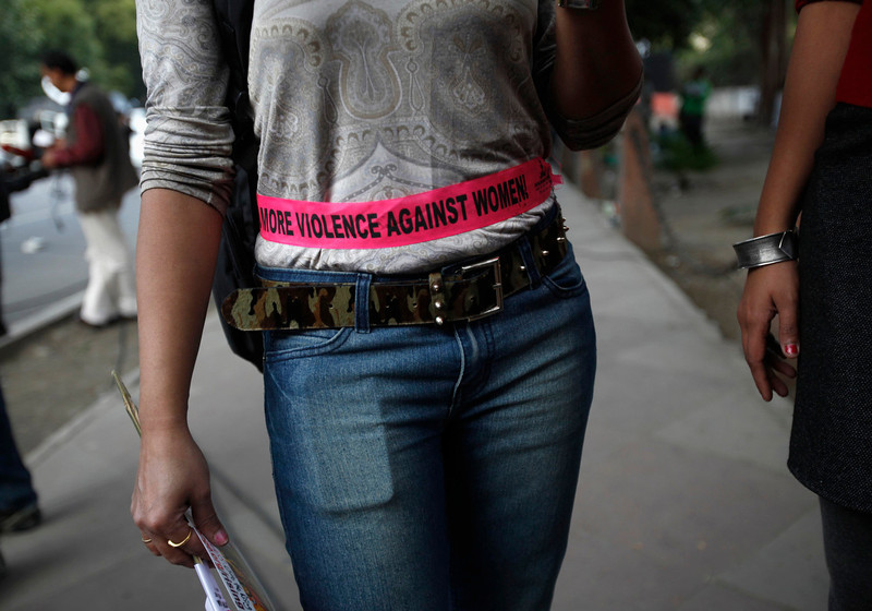 ". A woman stands on a pavement as she participates in the ""One Billion Rising\"" campaign in New Delhi February 14, 2013. One Billion Rising is a global coordinated campaign aimed to call for an end to violence against women and girls, according to its organisers.  REUTERS/Mansi Thapliyal"