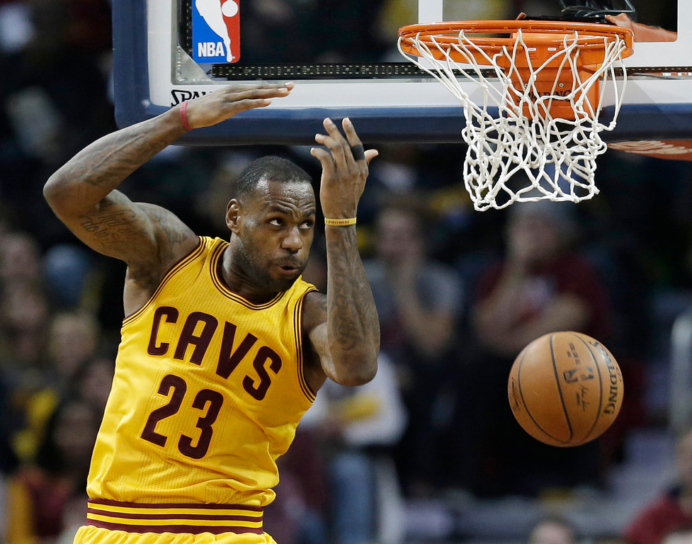 . Cleveland Cavaliers\' LeBron James looks back after dunking the ball against the Minnesota Timberwolves in the second half of an NBA basketball game Monday, Jan. 25, 2016, in Cleveland. The Cavaliers won 114-107. (AP Photo/Tony Dejak)