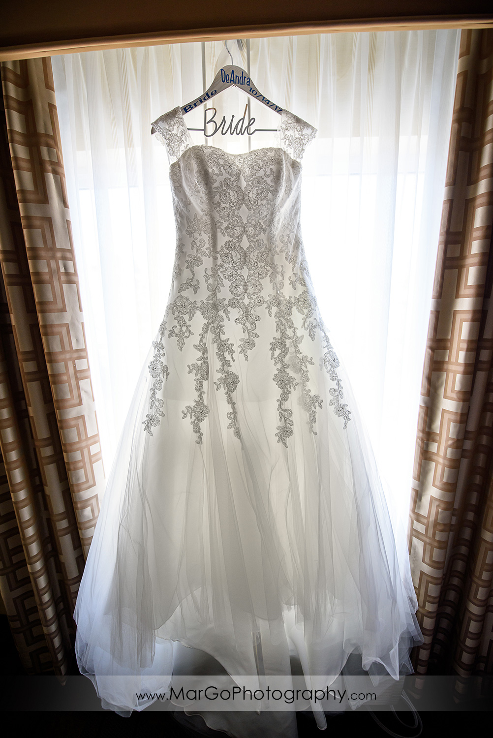 wedding dress hanging in the window at Best Western Plus Delta Inn & Suites in Oakley