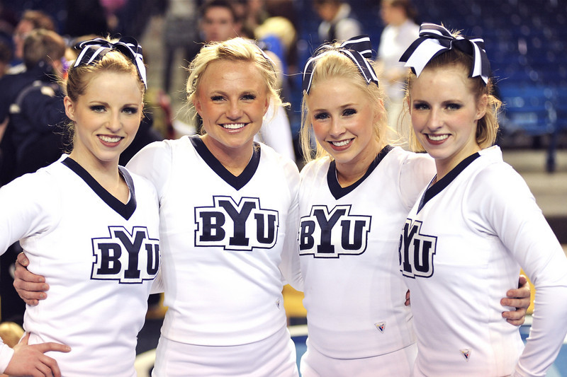 2011/2/22 1 of 2 – Normally I would only do one photo for the day but there are two today. This evening Lisa and I went to see the BYU cheerleaders preform their routine they will use at nationals this weekend. Sean's girlfriend is on the team. They did a great job and I shot nearly 400 photos but my favorite was Brooke and her friends. Brooke is second from the left. Second from the right is one of her best friends, Whitney, who is Jimmer Fredettes girlfriend. Jimmer is BYU's star point guard and one of the top basketball players in the country right now. Of course Jimmer had to be there to support Whitney so I couldn't pass posting a photo of him as well – see the next photo.  Brooke introduced me to many of the cheerleaders as Sean's dad. They all said they love Sean and all had some funny story about Sean, or told me how sweet he was. I guess he cooked dinner for the cheerleaders regularly. They all loved him. I don't think we had a clue how much fun Sean was having his freshman year at BYU