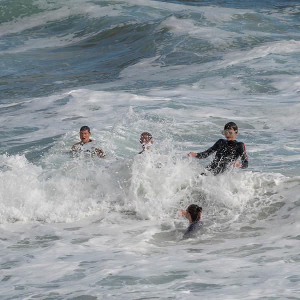 Family surfing in the Atlantic Ocean, Ballyferriter, County Kerry, Ireland