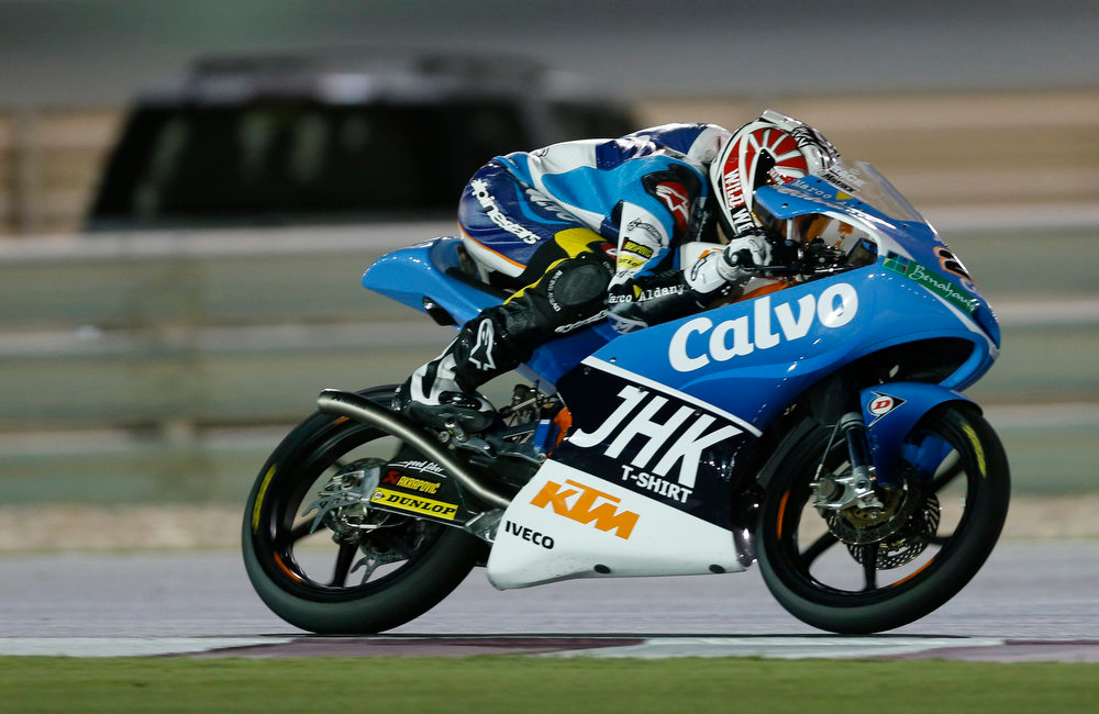 . Second-placed Team Calvo Moto3 rider Maverick Vinales of Spain rides his bike during the Qatar MotoGP Grand Prix at the Losail International circuit in Doha April 7, 2013. REUTERS/Fadi Al-Assaad