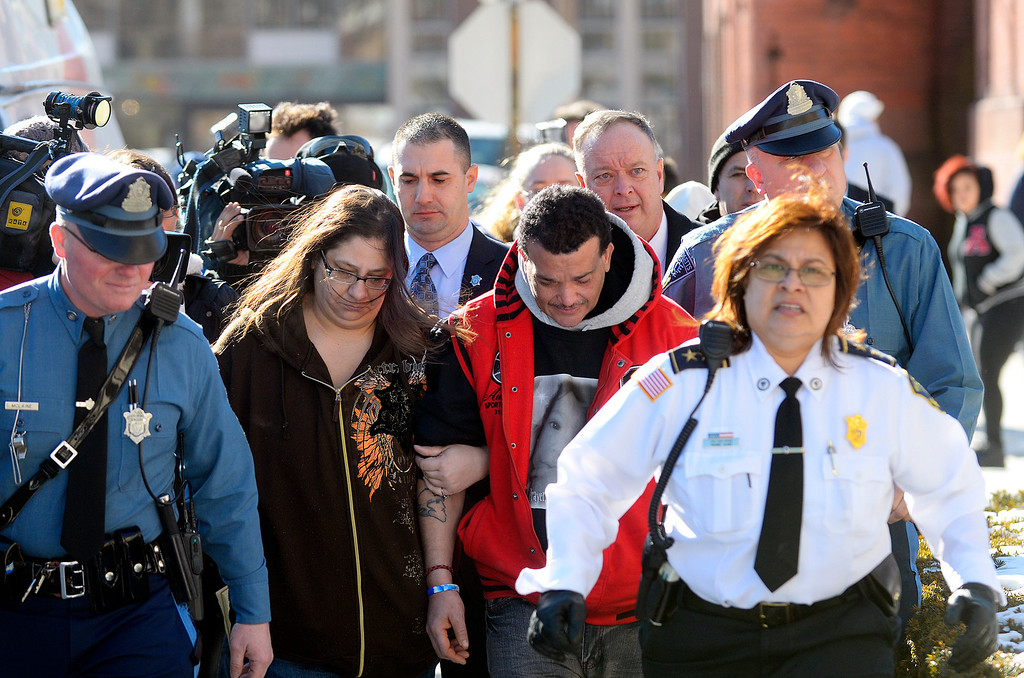 . Sandrino Oliver (2nd from right), uncle of missing 5-year-old Jeremiah Oliver of Fitchburg, is escorted back into Fitchburg District Court after a verbal outbreak that started in the courtroom following the competency hearing of Elsa Oliver, Friday. Left of Sandrino is Rose Valcourt, Jeremiah\'s paternal aunt.  SENTINEL & ENTERPRISE / BRETT CRAWFORD