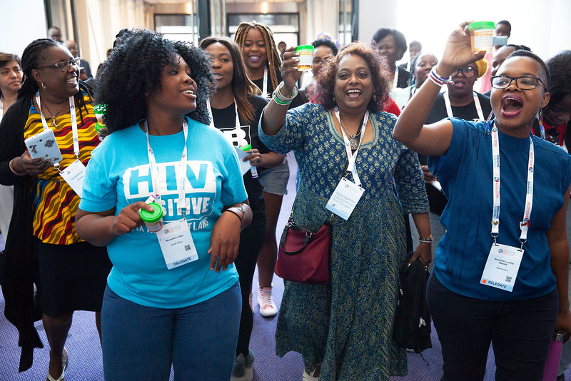 The Netherlands, Amsterdam, 22-7-2018. Audience, speakers and discussion of TB2018. A group of young women from S Africa with HIV-positive-T-shirts singing and dancingt after a TB2018 meeting.Photo: Rob Huibers for IAS. High resolution file.(Please publish always with complete attribution).
