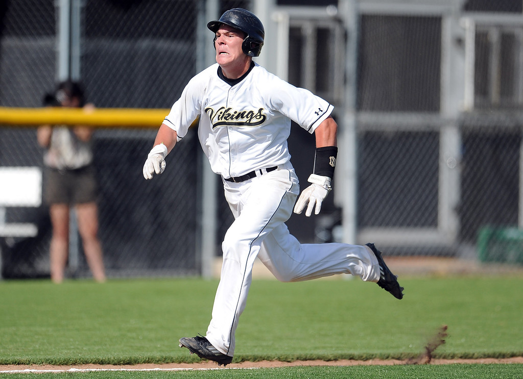 . Northview\'s Kollby Oriti scores on a wild pitch in the third inning of a prep baseball game against Baldwin Park at Northview High School on Tuesday, April 23, 2012 in Covina, Calif. Northview won 8-2.    (Keith Birmingham/Pasadena Star-News)