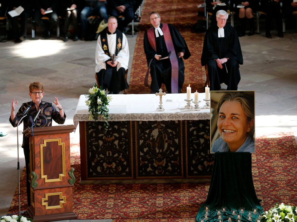 . Associated Press Senior Vice President and Executive Editor Kathleen Carrol, left, speaks during the funeral of Associated Press photojournalist Anja Niedringhaus in Hoexter, Germany, Saturday, April 12, 2014. Niedringhaus was killed by an Afghan policeman in an attack on April 4, 2014 in Afghanistan.(AP Photo/Frank Augstein, pool)