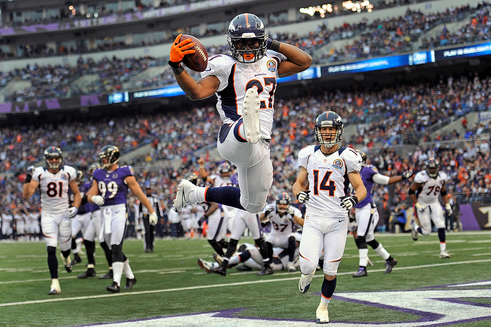 Description of . Denver Broncos running back Knowshon Moreno leaps into the air to celebrate his touchdown during the second half of an NFL football game against the Baltimore Ravens in Baltimore, Sunday, Dec. 16, 2012. (AP Photo/Nick Wass)