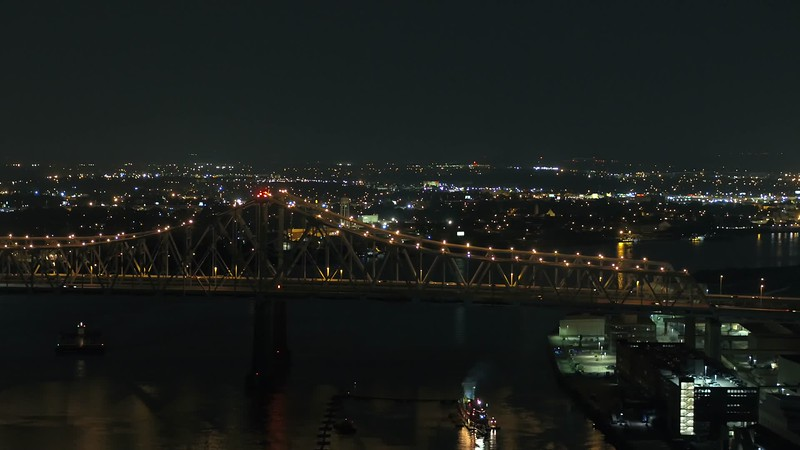 Night aerial drone video of the Crescent City Connection New Orleans over Mississippi River