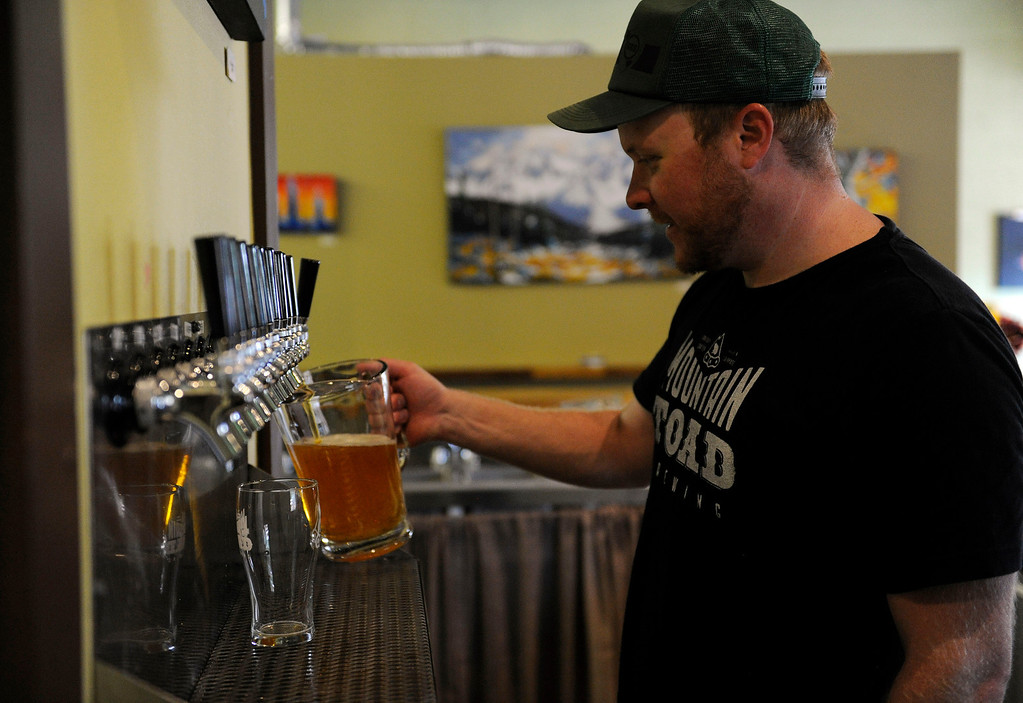 . GOLDEN, CO - AUGUST 23: Matt Weatherbee pours a pitcher of beer at Mountain Toad Brewing on August 23, 2013, in Golden, Colorado. The brewery opened in May. (Photo by Anya Semenoff/YourHub)