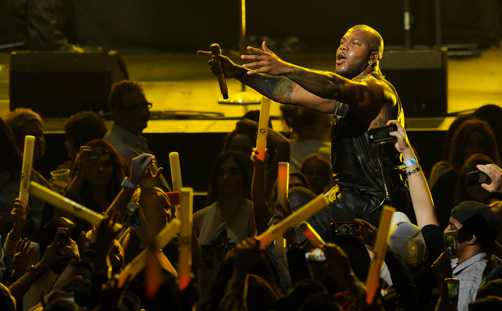 Description of . Flo Rida wades into the audience during his performance on the second night of KIIS FM's Jingle Ball at Nokia Theatre LA Live on Monday, Dec. 3, 2012, in Los Angeles. (Photo by Chris Pizzello/Invision/AP)