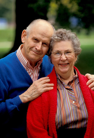 Elderly couple smiling at camera, senior couple
