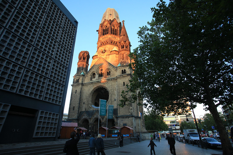 Kaiser Wilhelm Memorial Church. This church was ravaged by bombs during WWII and now only a protion of the building remains intact. I raced to take this shot before sunset and arrived just in the nick of time. I was able to capture the last light of day, and it gave the Wilhelm a holy glow that seemed to mask the bomb's burn marks that mar it's surface.