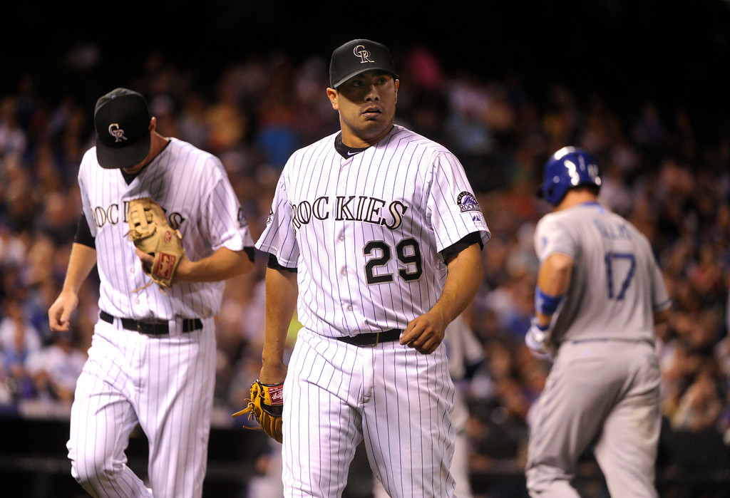 . DENVER, CO. - SEPTEMBER 4: Colorado starting pitcher Jorge De La Rosa walked off the mound after retiring LA batter A.J. Ellis in the sixth inning. The Colorado Rockies hosted the Los Angeles Dodgers at Coors Field Wednesday night, September 4, 2013.  Photo By Karl Gehring/The Denver Post